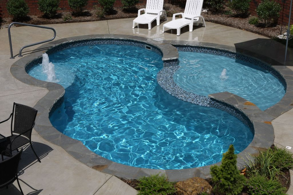 Fiberglass Pool and cutaway tanning ledge Swim World Pools