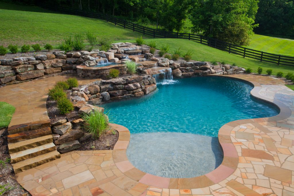 Custom pool with tanning ledge Swim World Pools