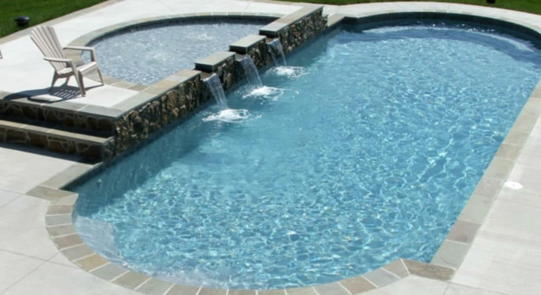 Trilogy Hyperion Classic Shaped Pool with raised Semicircle Tanning Ledge. Swim World Pools.
