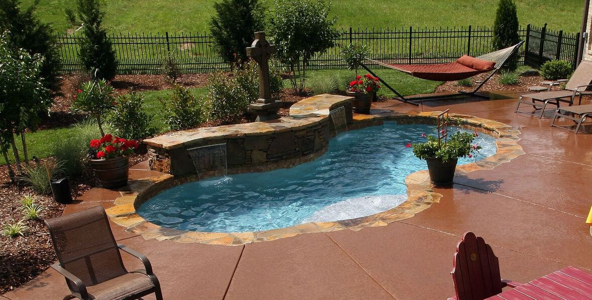 Trilogy Gemini Modern Freeform Shaped Pool. Swim World Pools.
